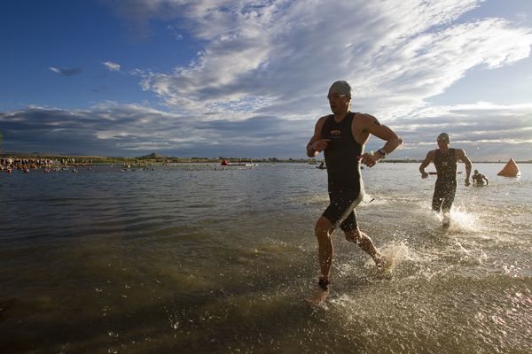 Tim DeBoom emerges from the water in the beautiful Boulder morning at the Ironman Boulder 70.3